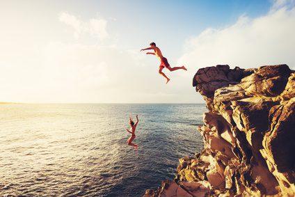 Cliff jumping man